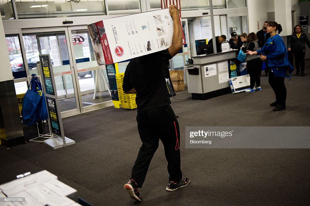 a shopper carries a hoover co vacuum box at a best buy inc store in paramus