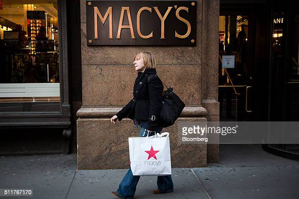 A shopper carries a Macy's Inc shopping bag outside of the department store in New York US on Monday Feb 22 2016 Macy's Inc the largest US...