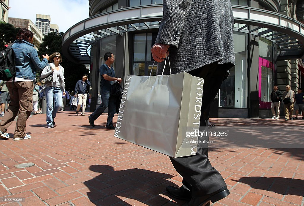 A shopper carries a Nordstrom bag as he walks along Market Street July 29, 2011 in San Francisco, California. The U.S. Commerce Department reported today that the U.S. economy slowed in the second quarter with the GDP coming in at 1.3 percent, far lower than expected.
