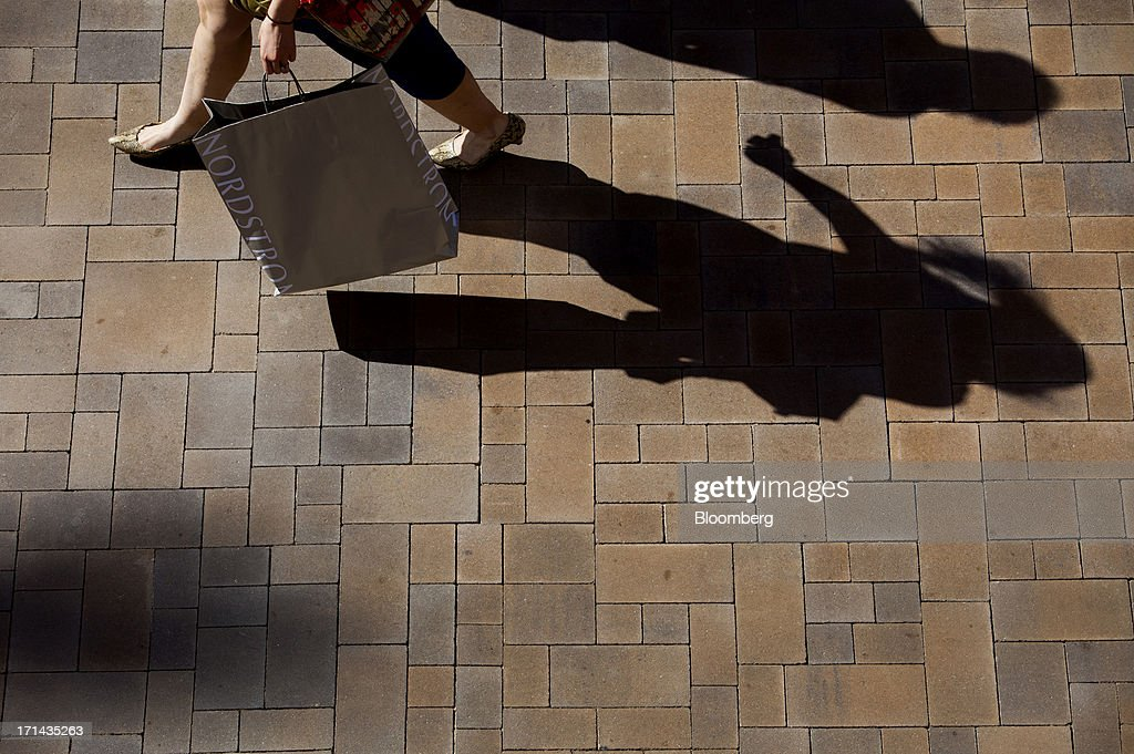 A shopper carries a Nordstrom Inc. bag while walking through the Fashion Valley Mall in San Diego, California, U.S., on Saturday, June 22, 2013. The Bureau of Economic Analysis is schedule to release personal consumption figures on June 26. Photographer: Sam Hodgson/Bloomberg via Getty Images
