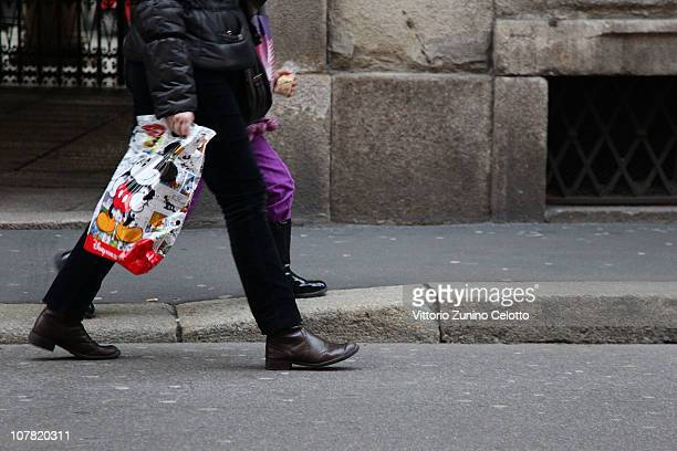 A shopper carries a plastic bag in the city centre on December 30 2010 in Milan Italy Italians currently use approximately 20 billion plastic bags...