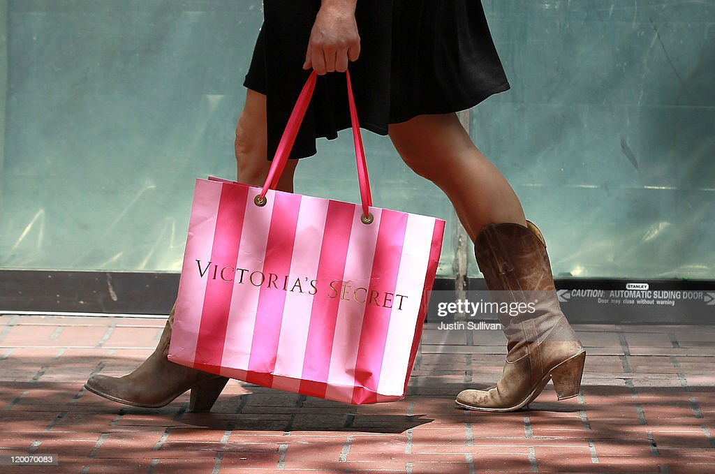 A shopper carries a Victoria's Secret bag as she walks along Market Street July 29, 2011 in San Francisco, California. The U.S. Commerce Department reported today that the U.S. economy slowed in the second quarter with the GDP coming in at 1.3 percent, far lower than expected.