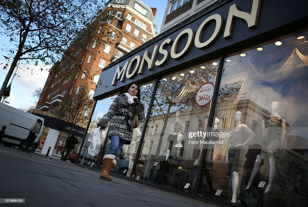 A shopper carries bags on the King's Road in Chelsea on December 5, 2012 in London, England. The Chancellor of the Exchequer George Osborne has stated that the United Kingdom's economy is still struggling during his Autumn budget statement to Parliament.