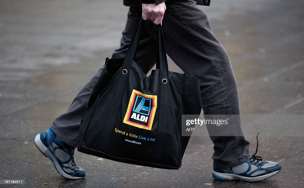 A shopper carries food from a branch of British food retailer Aldi in London on February 9, 2013. The British supermarket chain Aldi voiced anger on February 8 after finding that two of its own brand frozen ready meal ranges -- beef lasagne and spaghetti bolognese -- contained between 30 and 100 percent horsemeat. The meals were all produced in Luxembourg for French supplier Comigel, which said the horsemeat used originally came from a Romanian abattoir via a meat-processing firm called Spanghero in southwest France. AFP PHOTO / WILL OLIVER