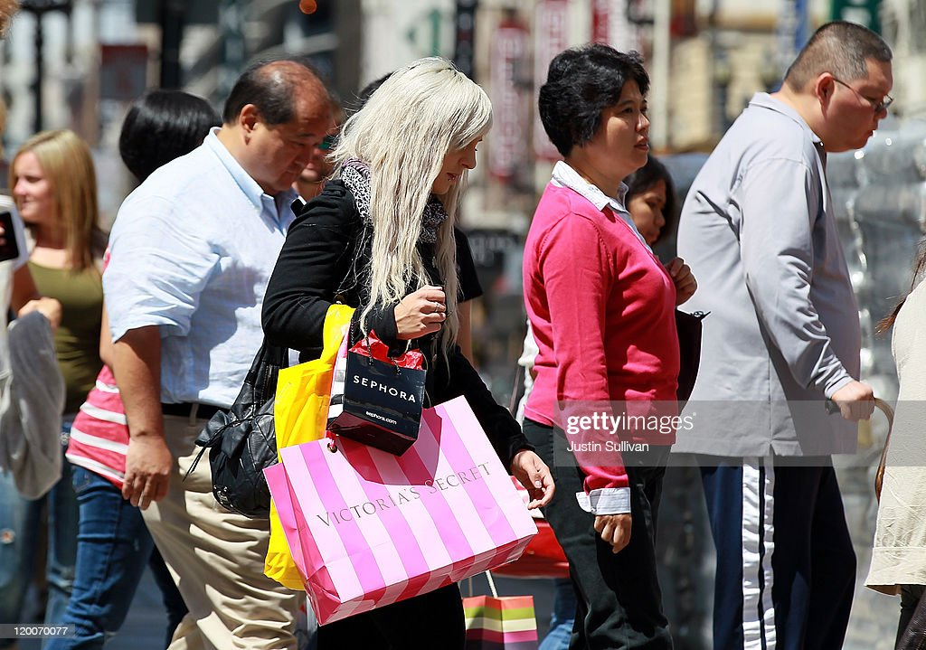 A shopper carries shopping bags as she walks along Stockton Street July 29, 2011 in San Francisco, California. The U.S. Commerce Department reported today that the U.S. economy slowed in the second quarter with the GDP coming in at 1.3 percent, far lower than expected.