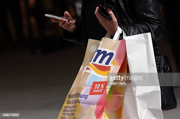 A shopper carries shopping bags during the opening of the Mall of Berlin on September 25 2014 in Berlin Germany The new shopping mall stands at...