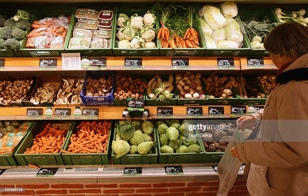 A shopper chooses from organic vegetables at a branch of German organic grocery store chain Bio Company on January 10, 2011 in Berlin, Germany. Organic foods retailers are reporting a surge in demand following the recent dioxin contamination scandal sparked by announcement by the German company Harles and Jentsch that some of the fatty proteins it had supplied to animals feeds producers was tainted with dioxin. German authorities responded by barring 4,700 mostly poultry and hog farms from selling their products until laboratory tests could guarantee them dioxin free. Investigators are meanwhile pursuing a criminal investigation against the leading employees at Harles and Jentsch.