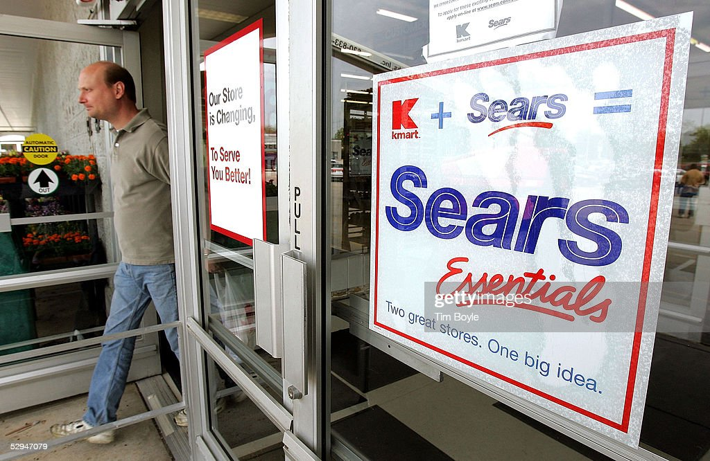 A shopper departs a current Kmart store May 18, 2005 in Palatine, Illinois. This particular Kmart is in transition to become one of Sears' new stores called 'Sears Essentials.' Kmart recently bought Sears, Roebuck and Co. for $12.3 billion.