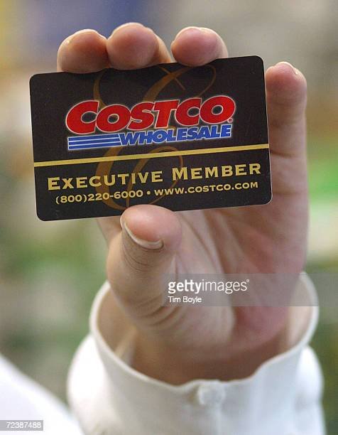 A shopper displays her Costco Wholesale membership card as she enters a Costco Wholesale store March 8 2002 in Niles IL Warehouse retailer Costco...