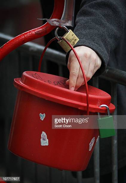 A shopper drops coins into a Salvation Army kettle on December 21 2010 in Chicago Illinois As the season winds down donations to Chicago area kettles...