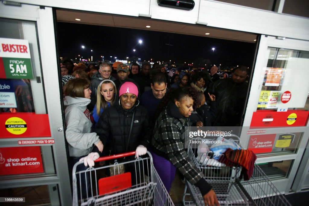 Shopper enter a Kmart as it opens on Thanksgiving night November 22, 2012 in Griffith, Indiana. City. Many stores got a head start on the traditional Black Friday sales by opening on Thanksgiving.