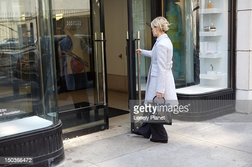 Shopper entering Barney's : Stock Photo