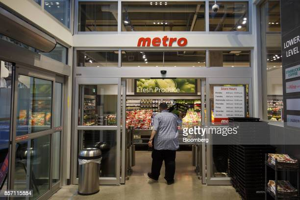 A shopper enters a Metro Inc grocery store in Toronto Ontario Canada on Monday Oct 2 2017 Canadian grocer Metro Inc agreed to buy pharmacy chain Jean...