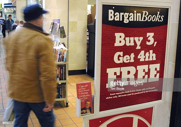 A shopper enters a Walden Books store advertising bargain books at GolfMill mall December 26 2001 in Niles IL Consumers rushed back to malls and...