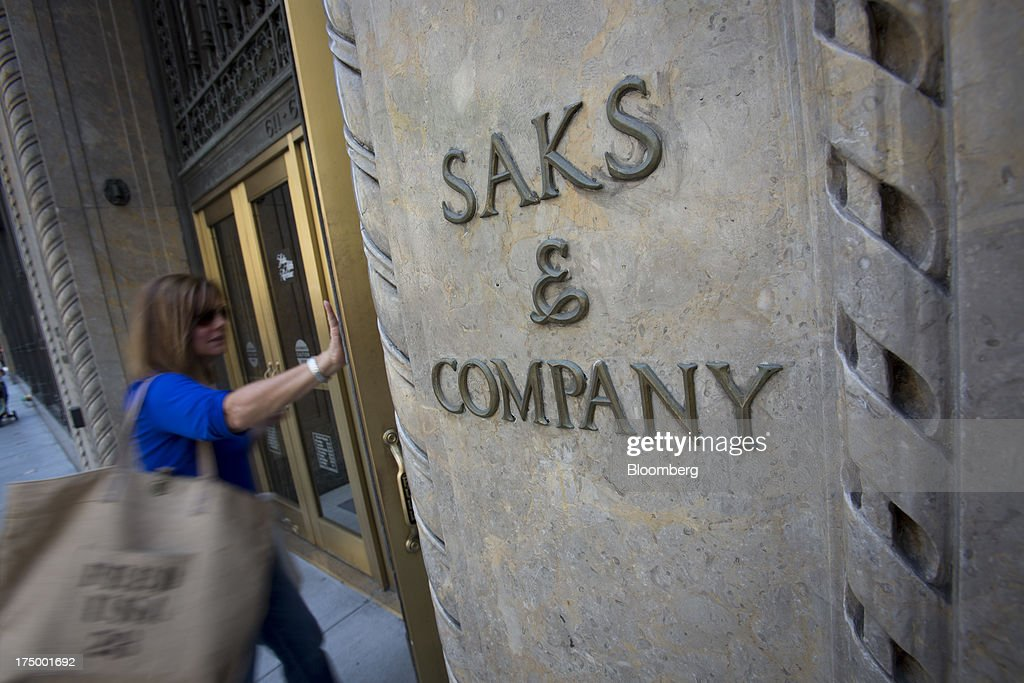 A shopper enters Saks Fifth Avenue in New York, U.S., on Monday, July 29, 2013. Hudson's Bay Co. agreed to buy Saks Inc. for $2.4 billion, combining Canada's largest-department store chain with one of the most prestigious U.S. luxury retailers in a deal that may spur the creation of a real estate investment trust. Photographer: Scott Eells/Bloomberg via Getty Images