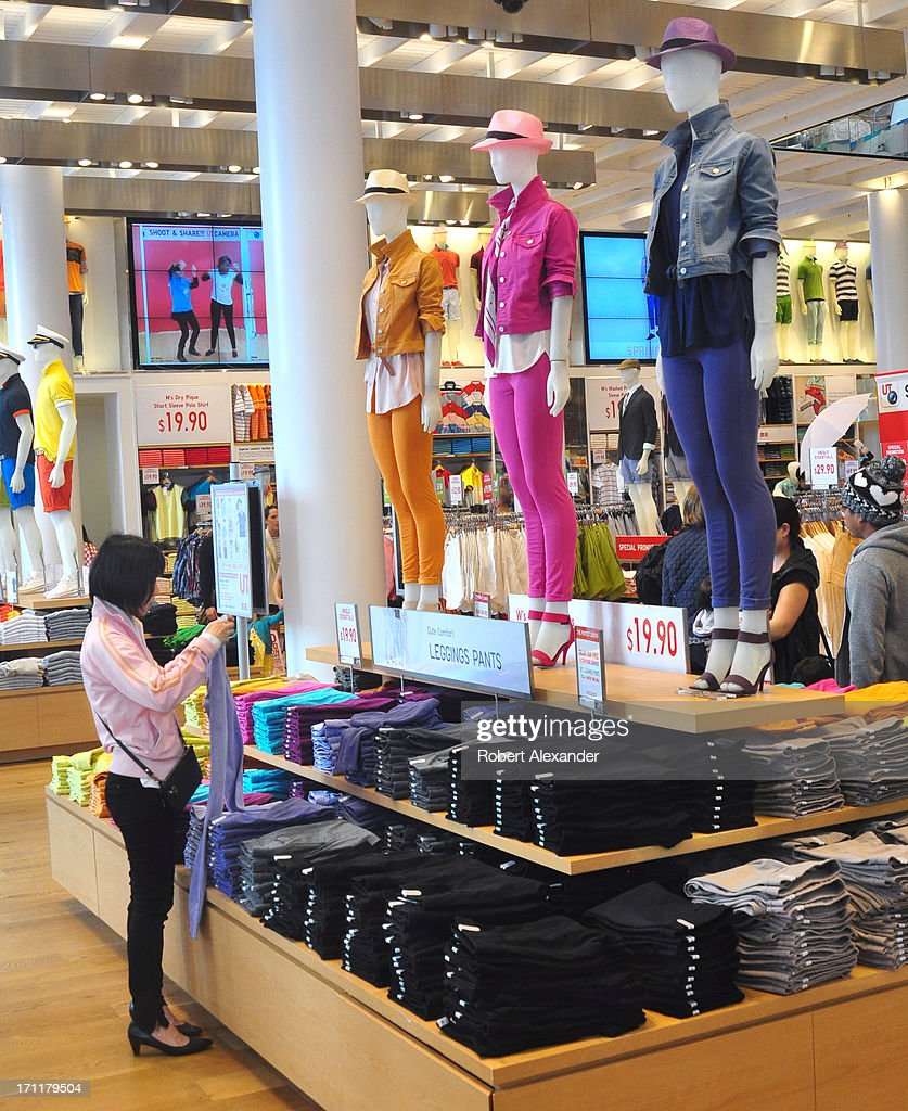 A shopper examines leggings pants at the Uniqlo store on Powell Street in San Francisco California The popular Japaneseowned clothing retailer in the...