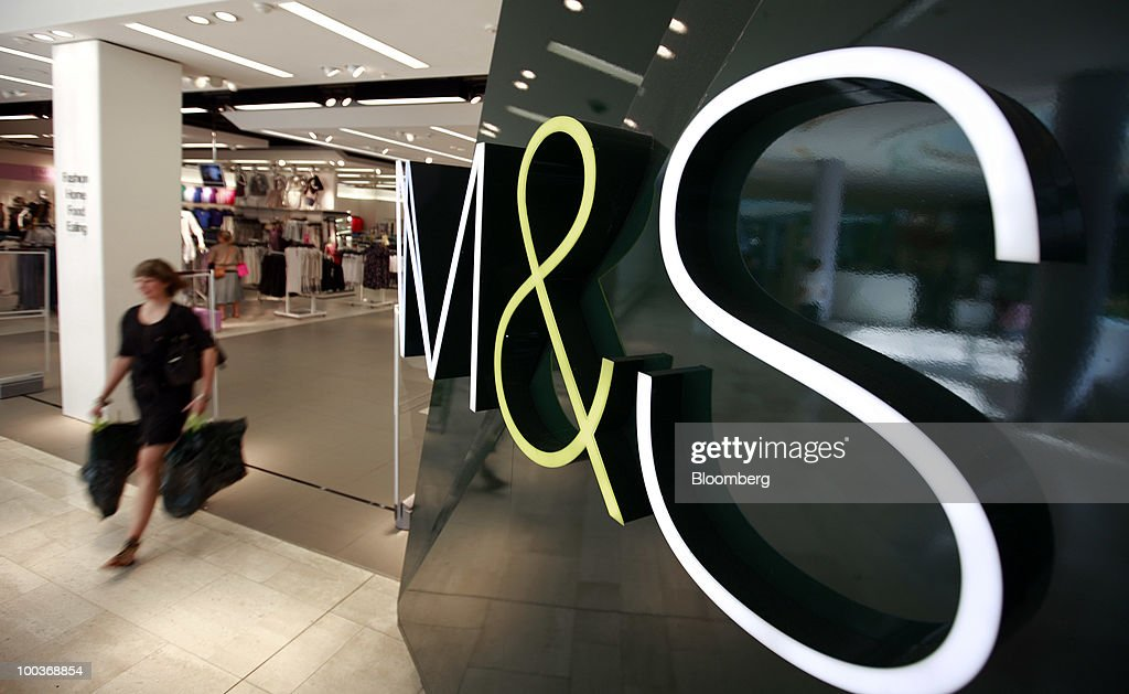A shopper exits a Marks & Spencer Group Plc (M&S) store in The Westfield Centre shopping mall in London, U.K., on Monday, May 24, 2010. The company, the U.K.'s biggest clothing retailer, reports its full-year earnings tomorrow. Photographer: Jason Alden/Bloomberg via Getty Images