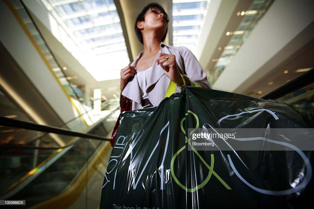 A shopper exits an escalator at a Marks & Spencer Group Plc (M&S) store in The Westfield Centre shopping mall in London, U.K., on Monday, May 24, 2010. The company, the U.K.'s biggest clothing retailer, reports its full-year earnings tomorrow. Photographer: Jason Alden/Bloomberg via Getty Images