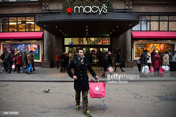 A shopper exits Macy's department store in Herald Square on December 26 2012 in New York City Shoppers flooded Manhattan stores for postChristmas...