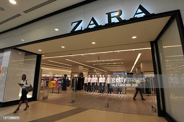 A shopper exits the newly opened store of Spanish clothing retailer Zara in Johannesburg on January 18 2012 Zara opened its first South African store...
