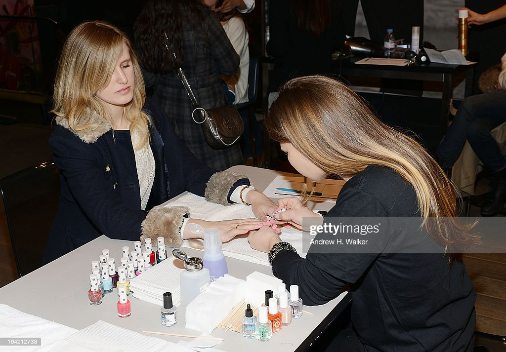 A shopper gets her fingernails painted at the Topshop Prom Event on March 20, 2013 in New York City. Models pose in Topshop prom looks.