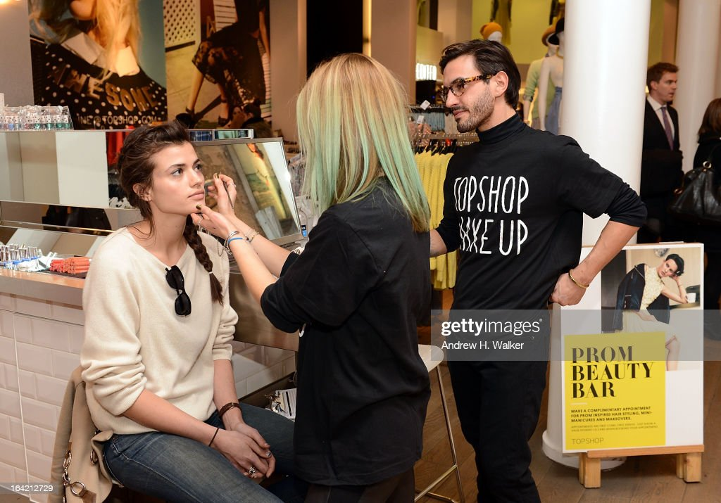 A shopper gets her make up done at the Topshop Prom Event on March 20, 2013 in New York City. Models pose in Topshop prom looks.