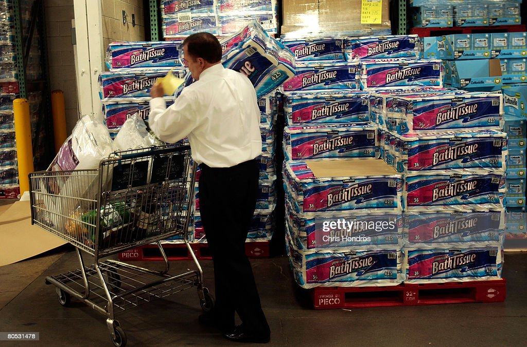 A shopper grabs a bulk package of toilet paper at a Costco store April 4, 2008 in Tucson, Arizona. As the American economy slows down, consumers are increasingly turning to thrifty measures to push their money further. Costco stores sell items in bulk, often reducing costs.