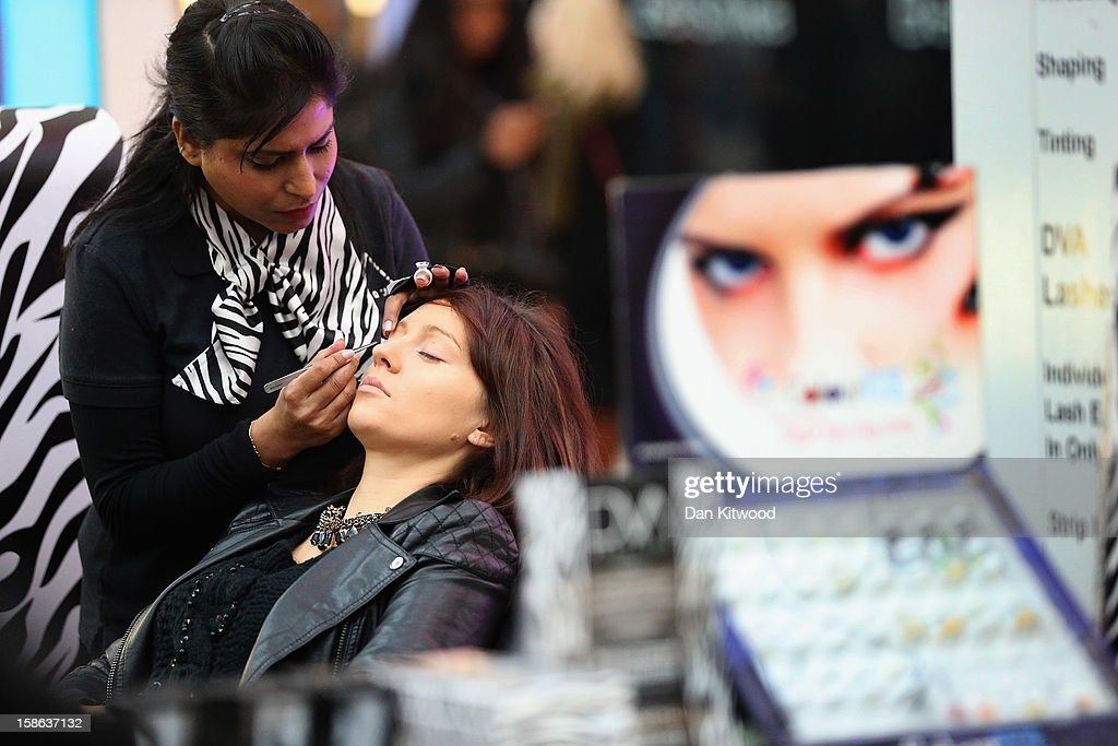 A shopper has a beauty session in Westfield Shopping centre in West London on December 22, 2012 in London, England. Today is the final Saturday before Christmas.