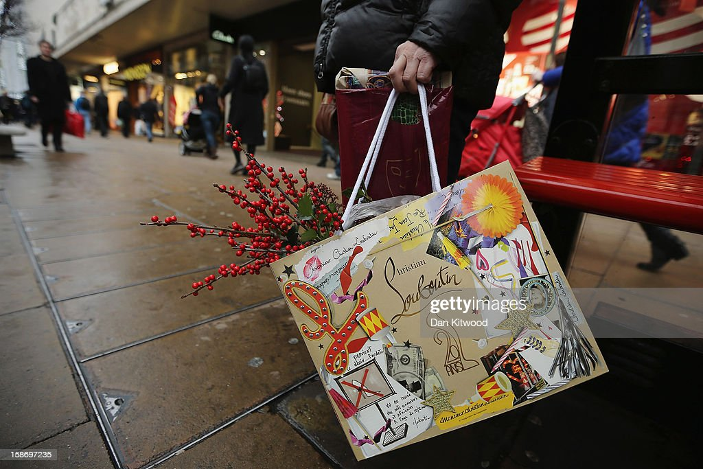 A shopper holds a bag on Regent Street on December 24, 2012 in London, England. Many high street retailers have started their sales two days early this year on what is expected to be the busiest shooping day of the year.