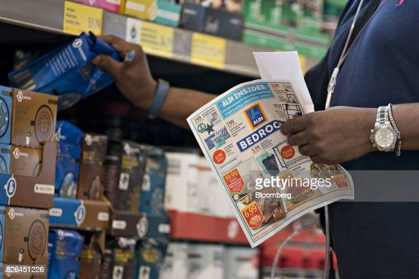 A shopper holds a circular while shopping at an Aldi Stores Ltd food market in Chicago Illinois US on Tuesday Aug 1 2017 Aldi known for low prices on...