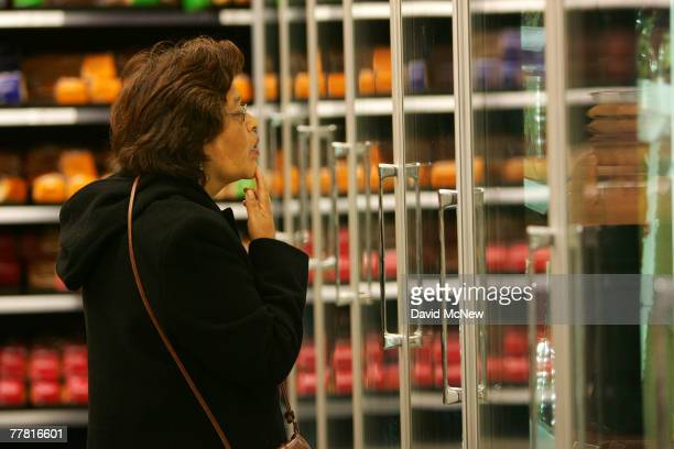 A shopper investigates the frozen foods section at a Fresh Easy grocery as Tesco PLC the UK's biggest retailer officially enters the US market...