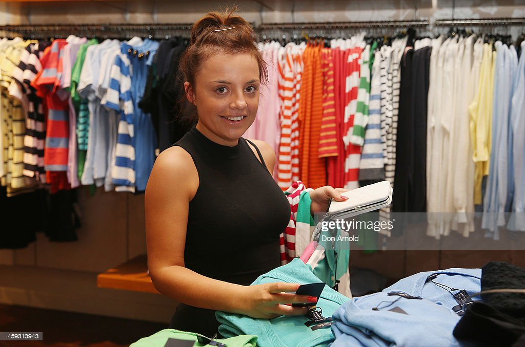 Shopper Jade Fullagar checks out the Boxing Day sales at David Jones in its city store on December 26, 2013 in Sydney, Australia. Boxing Day is one of the busiest days for retail outlets in Sydney with thousands takaing advantage of the post-Christmas sale prices.