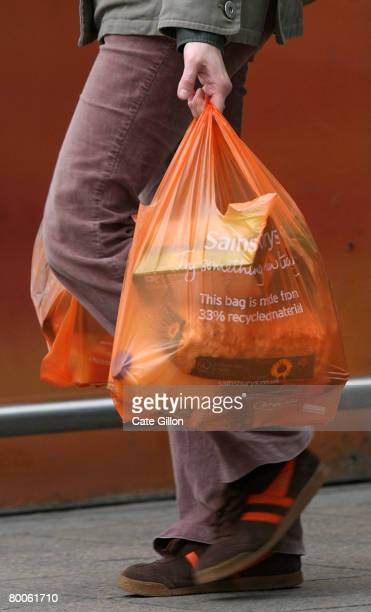 A shopper leaves a Sainsbury's store with her purchases in plastic bags on February 29 2008 in London England The Prime Minister Gordon Brown has...