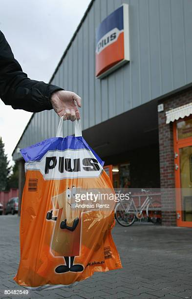 A shopper leaves a supermarket of German discount grocery chain Plus on April 2 2008 in Berlin Germany According to an investigation by the German...