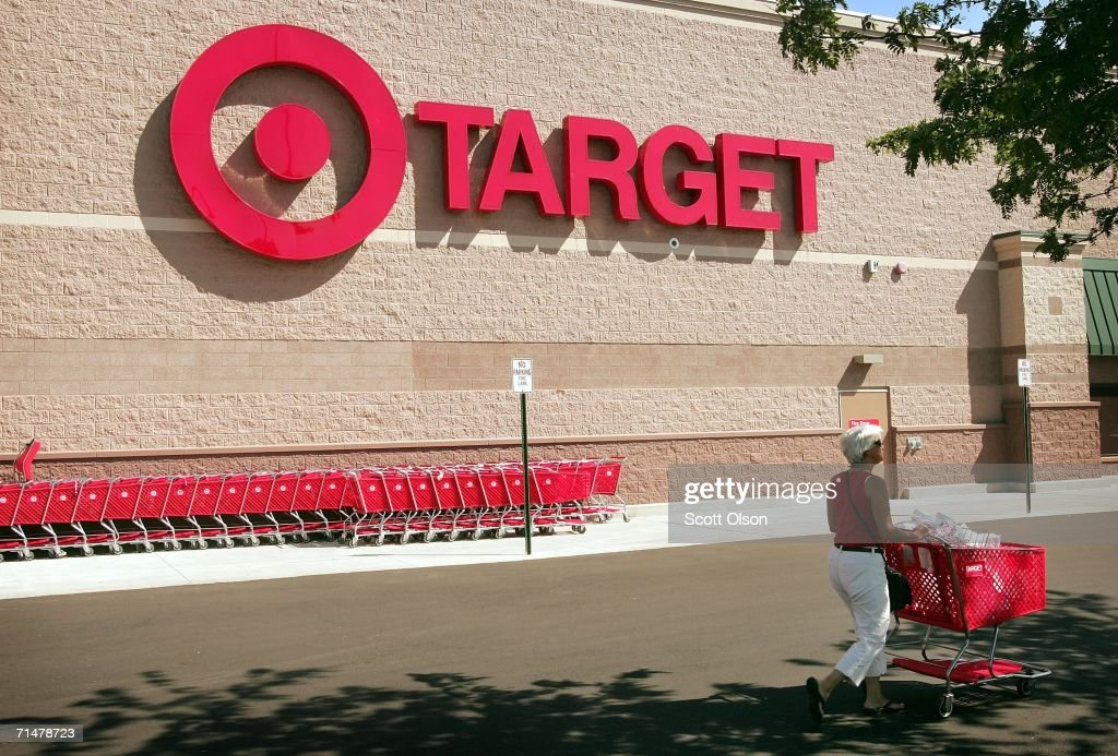 A shopper leaves a target store July 18, 2006 in Chicago, Illinois. Heightened concerns that energy prices are slowing consumer spending helped to drag shares of Target down today for their biggest one-day percentage slide in eight months.