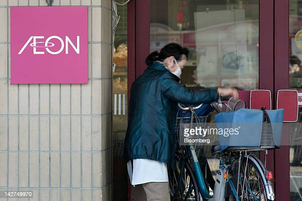 A shopper leaves an Aeon Co supermarket in Tokyo Japan on Thursday April 12 2012 Aeon Co Japan's largest supermarket operator reported consolidated...