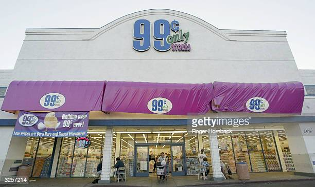 A shopper leaves one of the 99 Cents Only Stores April 7 2004 in Bakersfield CA The discount chains sales fell below it's first quarter expectations...