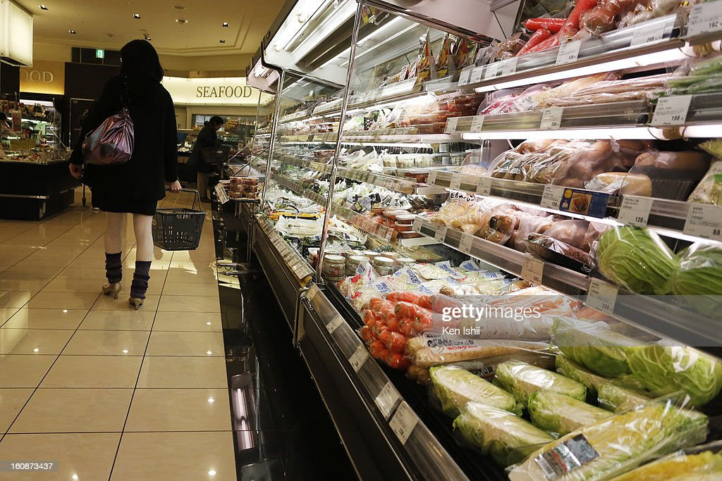 A shopper leaves vegetable shelf without buying at a supermarket on February 7, 2013 in Tokyo, Japan. A recent servey shows Tokyo as the most expensive city in the world and Osaka ranked second.