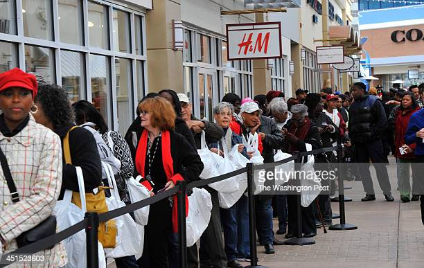 Shopper lined up outside the HM store some getting there as early as 5am to take part in the grand opening celebration of Tanger Outlets National...