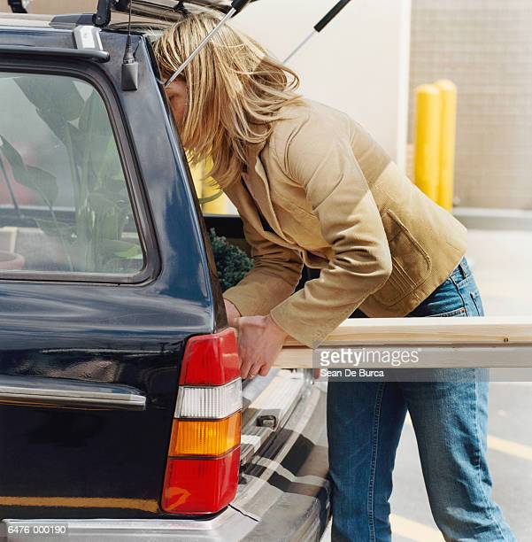 Shopper Loading Car Trunk