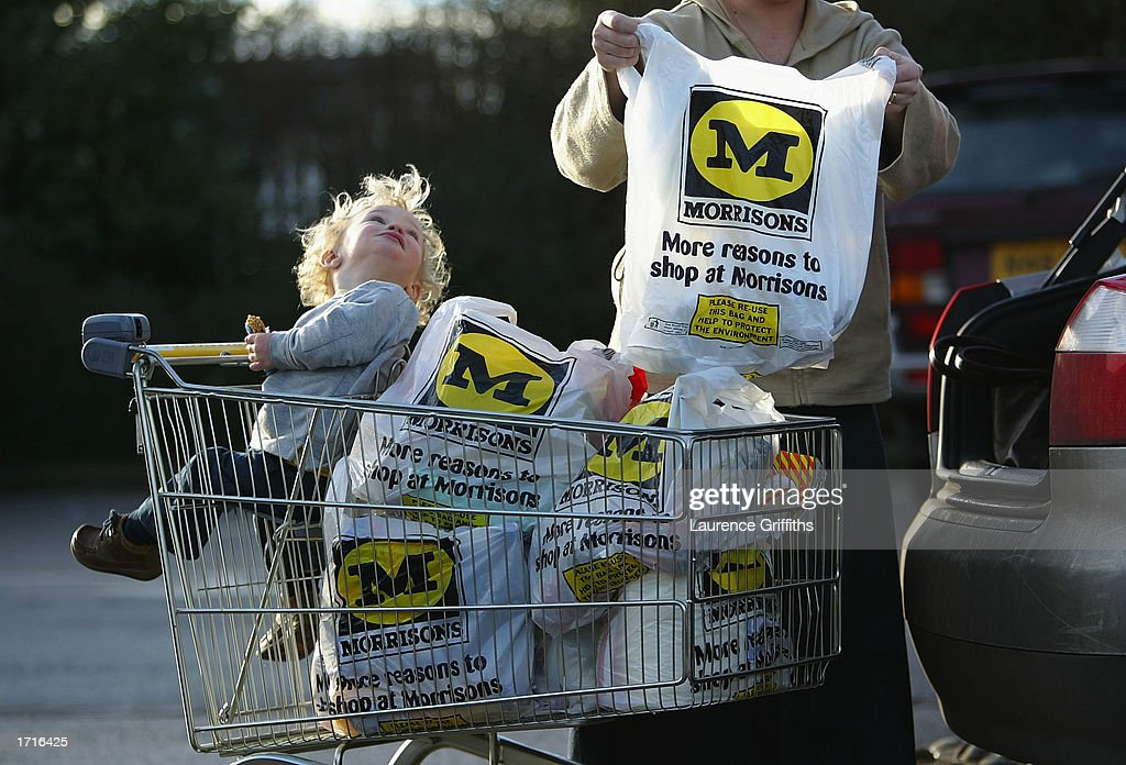 A shopper loads her car outside a Morrisons supermarket January 9, 2003 in Rochdale, Lancashire. The mid-size British supermarket chain, Morrisons, announced its bid to overtake rival Safeway in a 2.9 billion pound deal that would combine the firm with 589 stores and a 16 percent market share.