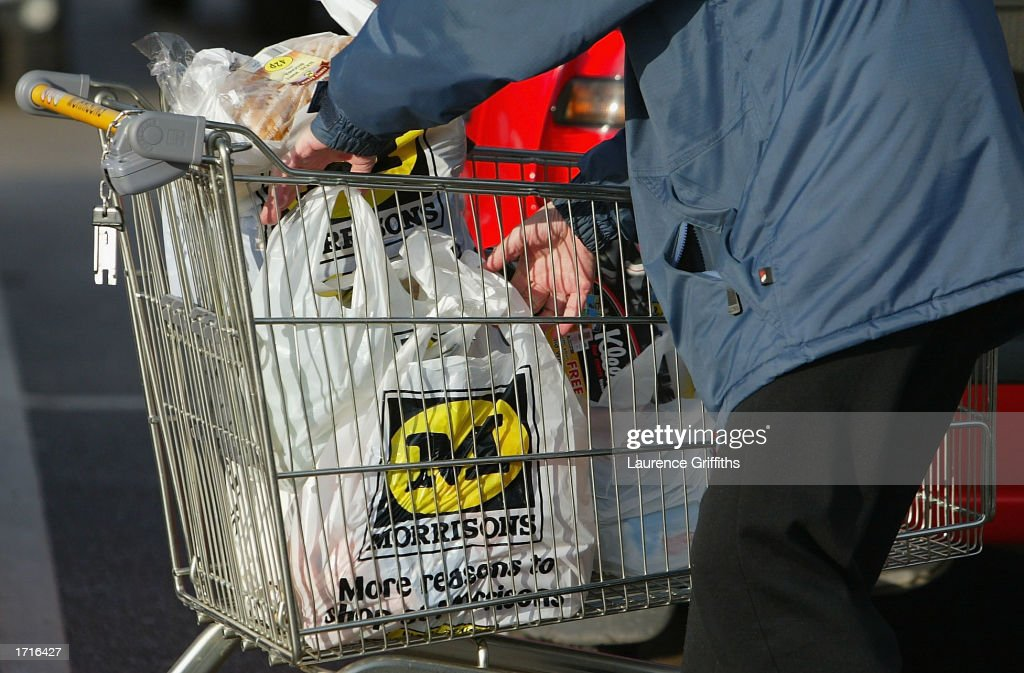 A shopper loads his car outside a Morrisons supermarket January 9, 2003 in Rochdale, Lancashire. The mid-size British supermarket chain, Morrisons, announced its bid to overtake rival Safeway in a 2.9 billion pound deal that would combine the firm with 589 stores and a 16 percent market share.