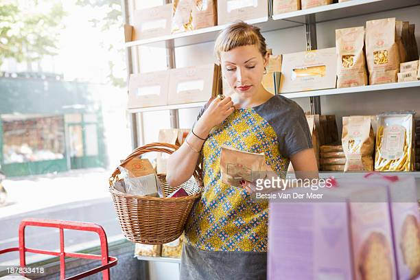Shopper looking at ingredients on package.
