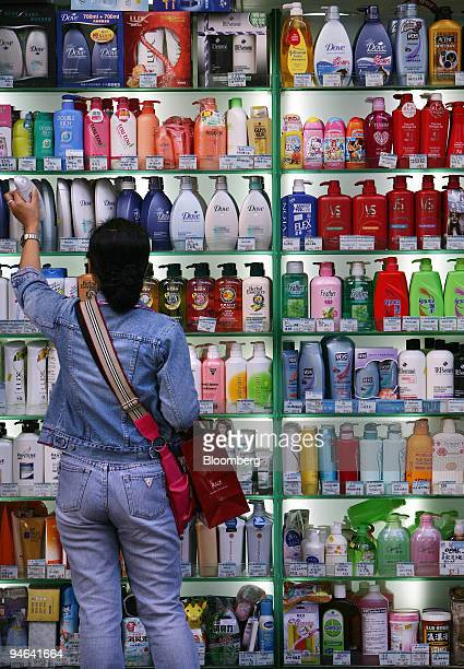 A shopper looks at a display of shampoos and soaps in the Causeway Bay area of Hong Kong China on Wednesday Dec 12 2007 Hong Kong's retail sales...