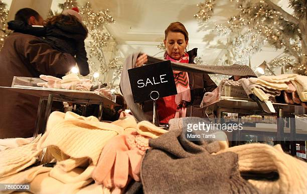 A shopper looks at a sale item in Saks Fifth Avenue December 20 2007 in New York City With Christmas five days away merchants are hoping lastminute...