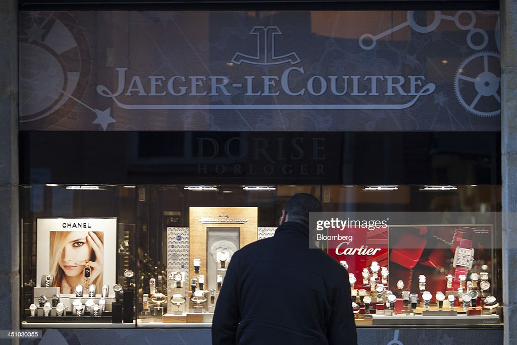 A shopper looks at a window display of luxury wristwatches at the Jaeger-LeCoultre store in Toulouse, France, on Wednesday, Nov. 20, 2013. France's gross domestic product fell 0.1 percent in the three months through September, national statistics office Insee said in an e-mailed statement. Photographer: Balint Porneczi/Bloomberg via Getty Images