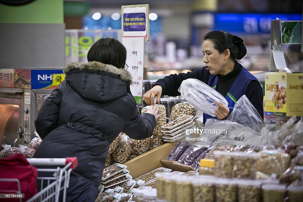 A shopper looks at bags of nuts at Hanaro Mart in Seoul, South Korea, on Tuesday, Feb. 26, 2013. South Korean consumer confidence remained at its highest level since May as gains in the won drove down the prices of imported goods. Photographer: Jean Chung/Bloomberg via Getty Images