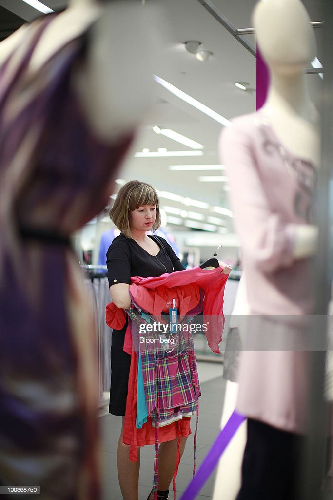 A shopper looks at clothing at a Marks & Spencer Group Plc (M&S) store in The Westfield Centre shopping mall in London, U.K., on Monday, May 24, 2010. The company, the U.K.'s biggest clothing retailer, reports its full-year earnings tomorrow. Photographer: Jason Alden/Bloomberg via Getty Images