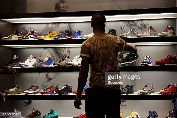A shopper looks at sneakers at the House Of Hoops by Foot Locker retail store at the Beverly Center in Los Angeles California US on Wednesday Aug 21...