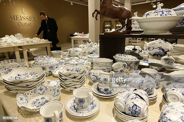 A shopper looks at tableware of German luxury porcelain maker Meissen at a Meissen store on January 19 2010 in Dresden Germany Officially called...